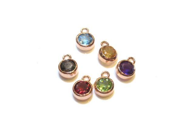 - Diamond and coloured stone charms